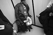 Quadir clings to his father Kevin Rahman Hutchins in the elevator of University Hospital before pre-op tests.  He still has bullet fragments on his brain and will undergo one more major surgery to repair the injury in his skull.