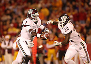 25 OCTOBER 2008: Texas A&M quarterback Jerrod Johnson (1) hands the ball off to Texas A&M running back Cyrus Gray (32) in the first half of an NCAA college football game between Iowa State and Texas A&M, at Jack Trice Stadium in Ames, Iowa on Saturday Oct. 25, 2008. Texas A&M beat Iowa State 49-35.