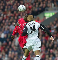 LIVERPOOL, ENGLAND - Sunday, November 4, 2001: Liverpool's Emile Heskey and Manchester United's Wes Brown during the Premiership match at Anfield. (Pic by David Rawcliffe/Propaganda)