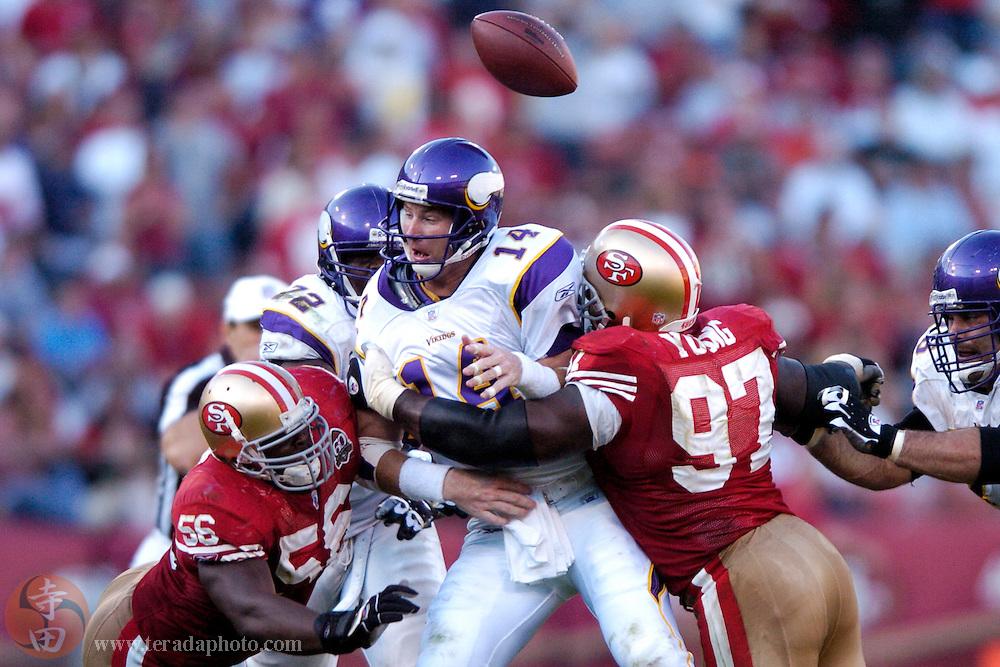 Nov 5, 2006 San Francisco, CA, USA: San Francisco 49ers linebacker Brandon Moore (56) forces Minnesota Vikings quarterback Brad Johnson (14) to fumble the football during the second half at Monster Park. The 49ers defeated the Vikings 9-3.