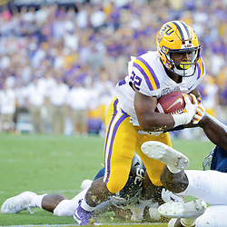 Aug 31, 2019; Baton Rouge, LA, USA; LSU Tigers running back Clyde Edwards-Helaire (22) runs against the Georgia Southern Eagles during the first quarter at Tiger Stadium. Mandatory Credit: Derick E. Hingle-USA TODAY Sports