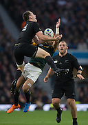 Twickenham. Great Britain,   left NZL's, Ben SMITH and RSA's, Willie LEROUX contest the higg ball, during, Semi Final 1. South Africa vs New Zealand  2015 Rugby World Cup,  Venue, Twickenham Stadium, Surrey England.   Saturday  24/10/2015.   [Mandatory Credit; Peter Spurrier/Intersport-images]