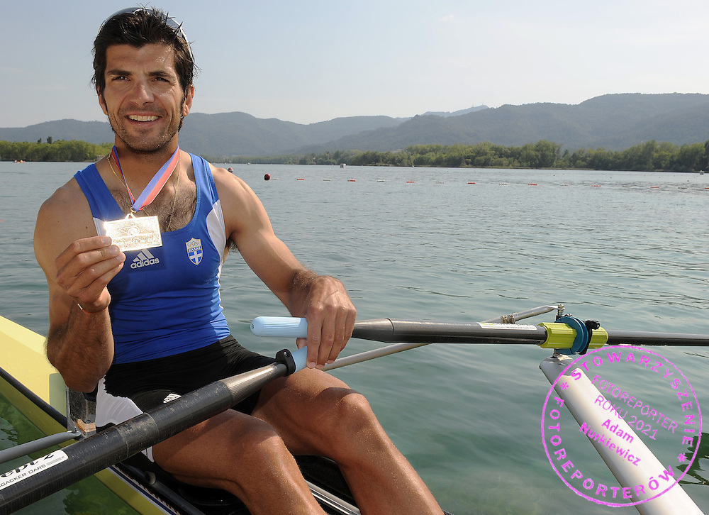 VASILEIOS POLYMEROS (GREECE) POSES WITH HIS GOLD MEDAL AT THE MEN'S LIGHTWEIGHT SINGLE SCULLS FINAL A DURING DAY 2 FISA ROWING WORLD CUP ON ESTANY LAKE IN BANYOLES, SPAIN...BANYOLES , SPAIN , MAY 30, 2009..( PHOTO BY ADAM NURKIEWICZ / MEDIASPORT )..PICTURE ALSO AVAIBLE IN RAW OR TIFF FORMAT ON SPECIAL REQUEST.