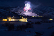 McPolin barn in winter with fireworks at The Canyons in background