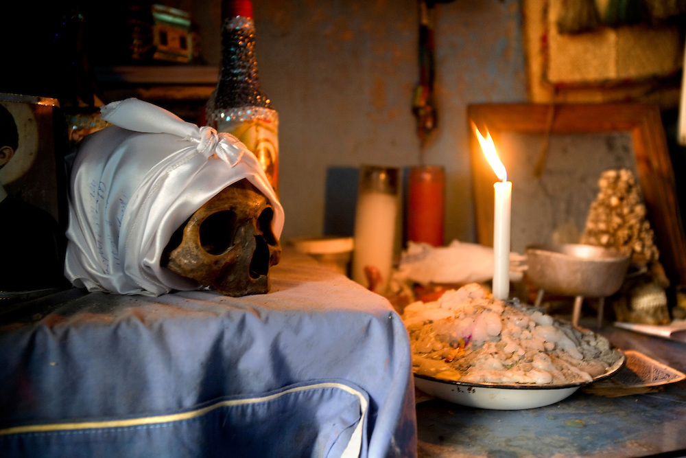 The skull of the mom of Joseph Gisme in Cité Soleil, Haiti on February 26, 2010. He took the skull from the graveyard after the spirit of his mom asked him to bring her home. His mom was a Mambo and he believes that she gave him power.