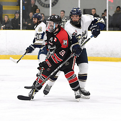 TORONTO, ON  - APR 10,  2018: Ontario Junior Hockey League, South West Conference Championship Series. Game seven of the best of seven series between Georgetown Raiders and the Toronto Patriots. Jason Smith #81 of the Georgetown Raiders battles for control with Dante Spagnuolo #15 of the Toronto Patriots during the second period.<br /> (Photo by Andy Corneau / OJHL Images)