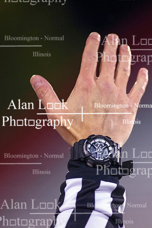 11 October 2019: Football official (referee) had in air showing game watch. Glenwood Titans at University High Pioneers boys football, Normal Illinois