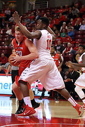 29 November 2014:  Bobby Hain works his way into the lane against John Jones during an NCAA men's basketball game between the Youngstown State Penguins and the Illinois State Redbirds  in Redbird Arena, Normal IL.
