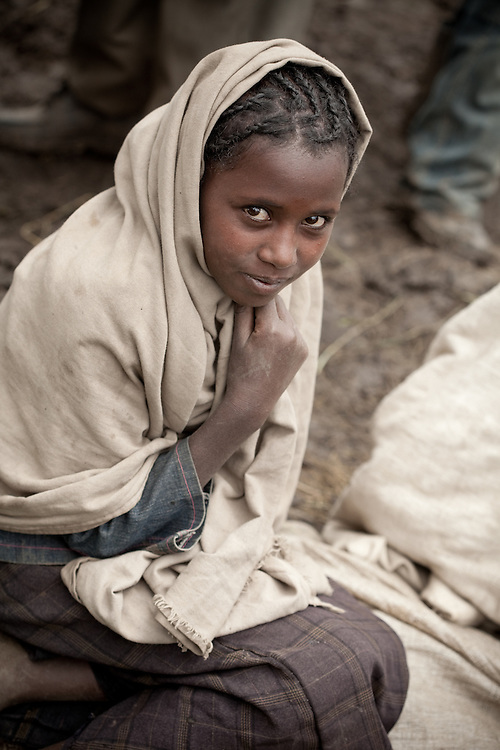 A girl wrapped in a blanket on Market day in Mehal Meda on the Guassa Plateau in the Ethiopian Highlands