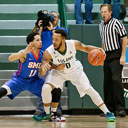 Jan 17, 2016; New Orleans, LA, USA; Tulane Green Wave guard Louis Dabney (0) is defended by Southern Methodist Mustangs guard Nic Moore (11) during the first half of a game at the Devlin Fieldhouse. Mandatory Credit: Derick E. Hingle-USA TODAY Sports