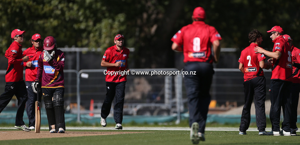 Ryan McCone of the Wizards is congratulated by George Worker after claiming the wicket of Jono Boult of the Knights during the Ford Trophy cricket match between the Canterbury Wizards v Northern Knights at Hagley Oval, Christchurch. 26 March 2014 Photo: Joseph Johnson/www.photosport.co.nz