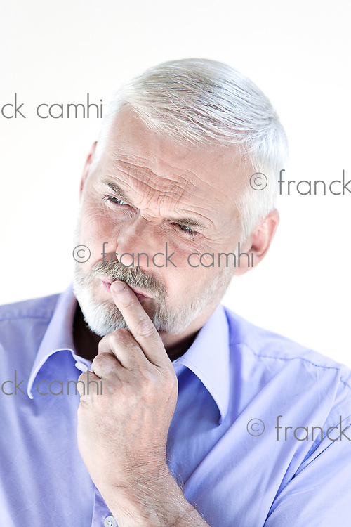 caucasian senior man portrait pensive isolated studio on white background
