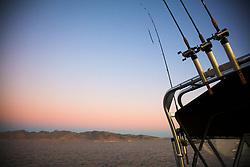 """""""Fishing Pyramid Lake, 1"""" - Sunset photograph of fishing poles on a boat at Pyramid Lake, Nevada."""