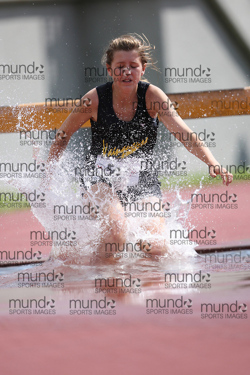 Sherbrooke, Quebec ---08/08/09--- \\ of \#2\ competes in the 2000 metre steeplechase at the 2009 Legion Canadian Youth Track and Field Championships in Sherbrooke, Quebec, August 10, 2009..HO/ Athletics Canada (credit should read GEOFF ROBINS/Mundo Sport Images/ Athletics Canada)..