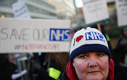 © Licensed to London News Pictures. 12/01/2016. London, UK. A campaigner joins junior doctors on a picket line outside St Thomas' Hospital.  Doctors are holding a one day strike over proposed new working hours - the first strike in 40 years. Photo credit: Peter Macdiarmid/LNP