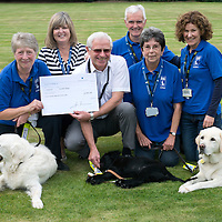 The Edrington Group, retirement of Alan Carlile who presented a Cheque to Guide Dogs Scotland, pictured from left, Deidre McVean with dog Lister, Janice Carlile,  Alan Carlile with puppy Wendy, Bob Donald, Margaret Findlater with dog Harry and Wendy Donald.<br /> Picture by Graeme Hart.<br /> Copyright Perthshire Picture Agency<br /> Tel: 01738 623350  Mobile: 07990 594431