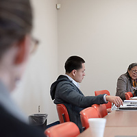 Founding Director Gloria Ann Begay, of the Diné Food Sovereignty Alliance (DFSA), listens to the groups as she looks to push efforts into areas needing more help during the Farm to School Initiative in Crownpoint Wednesday.