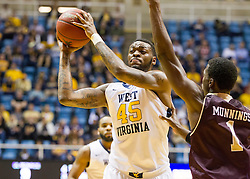 Dec 13, 2015; Morgantown, WV, USA; West Virginia Mountaineers forward Elijah Macon (45) passes out to a teammate during the first half against the Louisiana Monroe Warhawks at WVU Coliseum. Mandatory Credit: Ben Queen-USA TODAY Sports