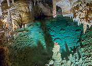 "Halo Lake is an attractive green pool of water in Caverns of Sonora, Sutton County, Texas, USA. The world-class Caverns of Sonora have a stunning and sparkling array of speleothems (helictites, stalactites, stalagmites, flowstone, coral trees, and other calcite crystal formations). National Speleological Society co-founder, Bill Stephenson said, after seeing it for the first time, ""The beauty of Caverns of Sonora cannot be exaggerated...not even by a Texan!"" Geologically, the cave formed between 1.5 to 5 million years ago within 100-million-year-old (Cretaceous) Segovia limestone, of the Edward limestone group. A fault allowed gases to rise up to mix with aquifer water, making acid which dissolved the limestone, leaving the cave. Between 1 and 3 million years ago, the water drained from the cave, after which speleothems begain forming. It is one of the most active caves in the world, with over 95% of its formations still growing. Sonora Caves are on Interstate 10, about half-way between Big Bend National Park and San Antonio, Texas. This panorama was stitched from 2 overlapping photos."