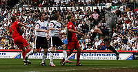 Photo: Steve Bond.<br />Derby County v Coventry City. Coca Cola Championship. 09/04/2007. Coventry keeper Andy Marshall (R) gathers under pressure
