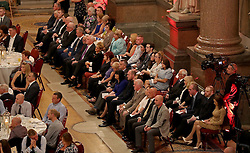 People attend a ceremony where the 96 victims of the Hillsborough disaster are posthumously awarded the Freedom of the City, at Liverpool Town Hall.