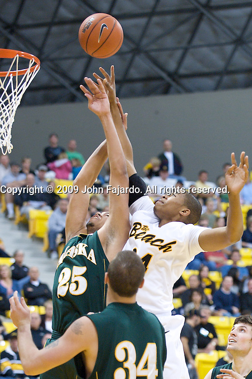 Kyle Richardson(r) fights for the rebound with Malcolm Campbell(25) in the men's season opener against University Alaska-Anchorage at the Walter Pyramid, Long Beach CA, Saturday, November 14, 2009.