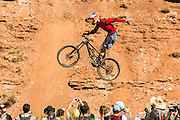 """Mountain biking competition in Virgin, Utah. Photo of a rider doing a """"no hander"""" while in the air."""