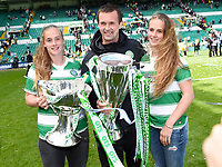 24/05/15 SCOTTISH PREMIERSHIP<br /> CELTIC v INVERNESS CT<br /> CELTIC PARK - GLASGOW<br /> Celtic manager Ronny Deila (centre) joins his daughters Thile (left) and Live as he celebrates with the Scottish League Cup and the Scottish Premiership trophy<br /> ** ROTA IMAGE - FREE FOR USE **