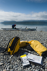A kayaker loads their sea kayak near Goose Cove in the Muir Inlet in Glacier Bay National Park and Preserve in southeast Alaska.