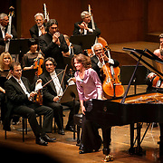 "March 11, 2013 - New York, NY : .Pianist Hélène Grimaud, in pink, takes a bow after performing Ludwig van Beethoven's Piano Concerto No. 4 in G major (1804-07) with the London Philharmonic Orchestra, as part of Lincoln Center's ""Great Performers"" series at Avery Fisher Hall on Monday evening..CREDIT: Karsten Moran for The New York Times"