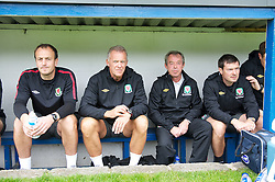 HAVERFORDWEST, WALES - Wednesday, August 10, 2011: Wales' manager Brian Flynn and his back room staff Alan Curtis and physiotherapist Dyfri Owen before the match against Hungary in the Under-21 International Friendly at the Conygar Bridge Meadow Stadium. (Photo by Gareth Davies/Propaganda)