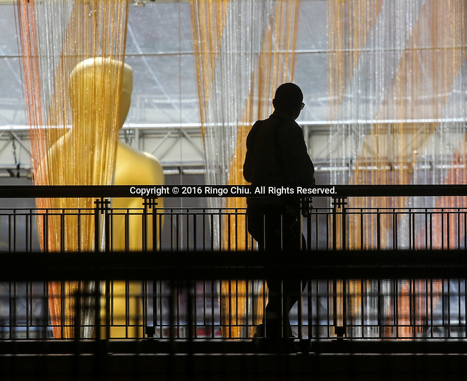 A man walks by the Oscar statue in front of the Dolby Theatre in Los Angeles, Wednesday, February 24, 2016. The 88th Academy Awards will be held Sunday, February 28, 2016. (Photo by Ringo Chiu/PHOTOFORMULA.com)<br /> <br /> Usage Notes: This content is intended for editorial use only. For other uses, additional clearances may be required.