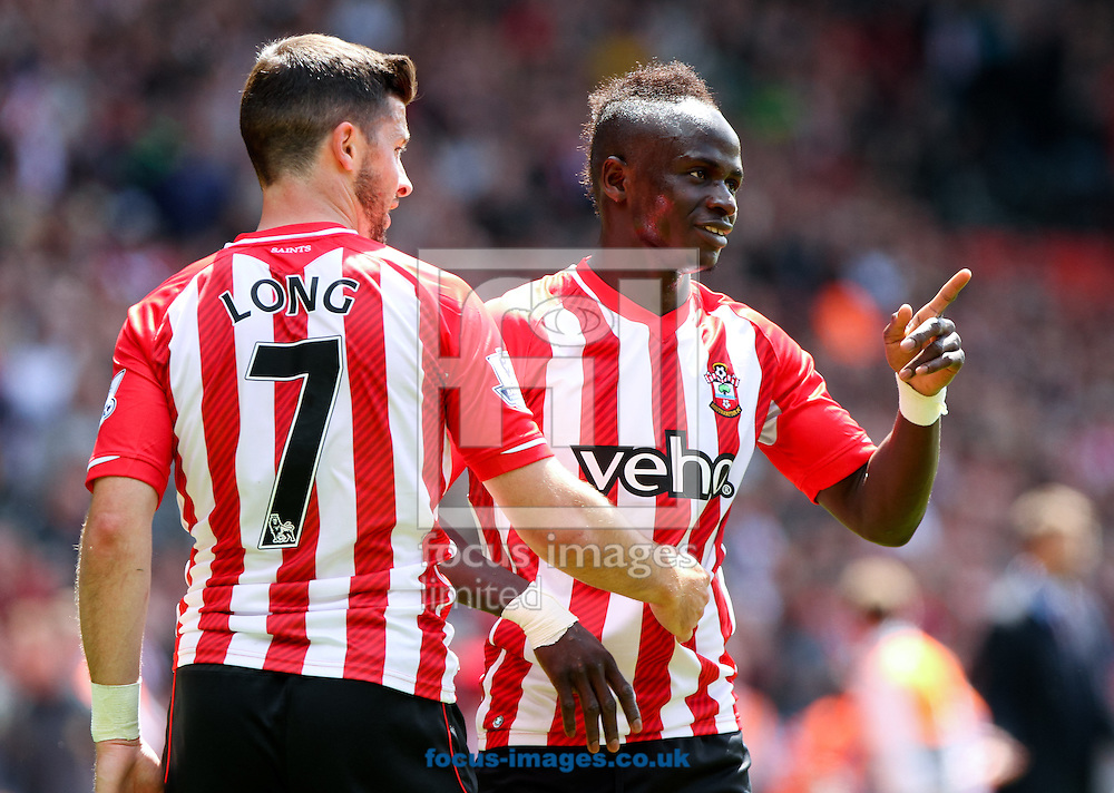 Shane Long (left) of Southampton celebrates scoring his sides fourth goal with his team mate Sadio Man&eacute; (right) during the Barclays Premier League match at the St Mary's Stadium, Southampton<br /> Picture by Tom Smith/Focus Images Ltd 07545141164<br /> 16/05/2015