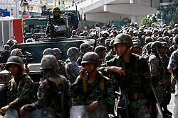 Thai soldiers prepare to crack down on anti-government protesters gathered outside Government House early morning in Bangkok, Thailand, 14 April 2009. Anti-government protests that shut down a weekend summit meeting and ruined Bangkok's annual Buddhist New Year celebrations ended suddenly 14 April after Thai army troops advanced on the demonstrators' last stronghold in Bangkok.
