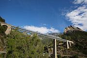 "The ""Micheline"" crossing the Viaduc du Vecchiu, a railway bridge constructed by famous French architect Gustave Eiffel."