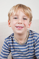 Close-up portrait of cute young boy smiling
