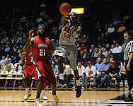 """Ole Miss' Jarvis Summers(32) vs. Louisiana-Lafayette's Darshawn McClellan (21) at C.M. """"Tad"""" Smith Coliseum in Oxford, Miss. on Wednesday, December 14, 2011. (AP Photo/Oxford Eagle, Bruce Newman)"""