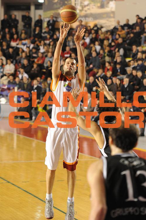 DESCRIZIONE : Roma Campionato Lega A 2011-12 Acea Roma Canadian Solar Bologna<br /> GIOCATORE : Michalis Kakiouzis <br /> CATEGORIA : three points<br /> SQUADRA : Acea Roma<br /> EVENTO : Campionato Lega A 2011-2012<br /> GARA : Acea Roma Canadian Solar Bologna<br /> DATA : 21/01/2012<br /> SPORT : Pallacanestro<br /> AUTORE : Agenzia Ciamillo-Castoria/GiulioCiamillo<br /> Galleria : Lega Basket A 2011-2012<br /> Fotonotizia : Roma Campionato Lega A 2011-12 Acea Roma Canadian Solar Bologna<br /> Predefinita :