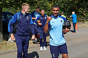 AFC Wimbledon striker Kweshi Appiah (9), AFC Wimbledon striker Joe Pigott (39) and AFC Wimbledon midfielder Scott Wagstaff (7) arriving during the EFL Sky Bet League 1 match between AFC Wimbledon and Shrewsbury Town at the Cherry Red Records Stadium, Kingston, England on 14 September 2019.