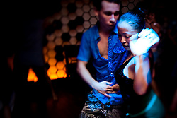 Dancers take part in a salsa group at a hotle bar in Hanoi, Vietnam