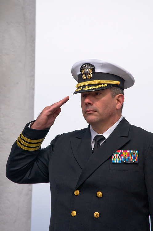 ARLINGTON, Virginia (March 28, 2011) -- U.S. Navy Cmdr. Richard Jadick renders honors during a remembrance ceremony at Arlington National Ceremony.  The event was held for family from around the country and for service members from all branches who gathered to honor 262 fallen medical service members who died in battle.  The Military Health System has hosted this event since 2009 and serves to bring families together who've lost loved ones that served as doctors, nurses, medics, corpsman and other medical personnel.  Photo by Johnny Bivera