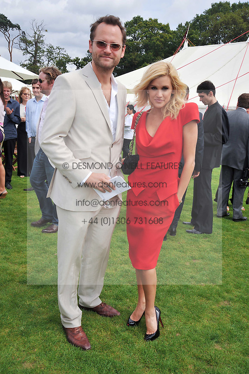 CHARLIE MUIRHEAD and ASHLEY ROBERTS at the 25th annual Cartier International Polo held at Guards Polo Club, Great Windsor Park, Berkshire on 26th July 2009.
