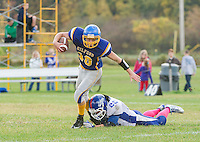 Gilford's Carter Mercer gets tripped up by Interlakes Manson Phu during NHIAA division III Football on Saturday afternoon.  (Karen Bobotas/for the Laconia Daily Sun)