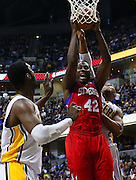 April 21, 2012; Indianapolis, IN, USA; Philadelphia 76ers power forward Elton Brand (42) shoots the ball as Indiana Pacers power forward David West (21) defends from behind at Bankers Life Fieldhouse. Philadelphia defeated Indiana 109-106. Mandatory credit: Michael Hickey-US PRESSWIRE