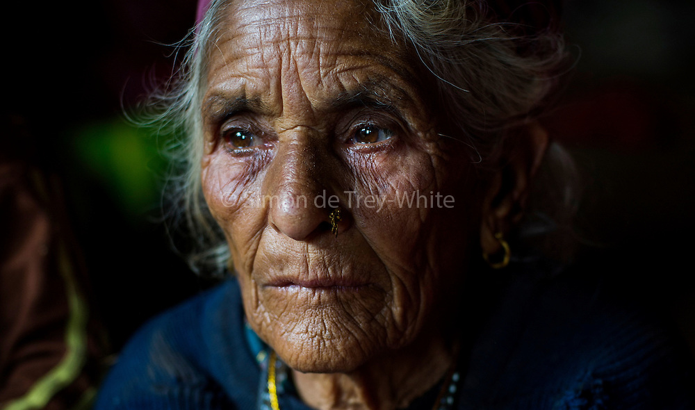 30th April 2015, Sindhupal Chowk District, Nepal. Manmaya Bharati (86)  in Bharatigaun village, Sindhupal Chowk District, on the 30th April 2015. She lived through the last major earthquake to hit Nepal 81 years ago in 1934, she was not old enough to remember it but was later told her father carried her on his shoulders to flee.<br /> <br /> Sindhupalchowk District has seen around 2100 deaths as of 3rd May 2015 which is nearly a third of all fatalities recorded in Nepal from the earthquake with magnitude 7.8 that occurred near Lamjung, Nepal, 50 miles northeast of the capital Kathmandu at 06:11:26 UTC on Apr 25, 2015. The capital has seen considerable devastation including the nine-story Dharahara Tower, one of Kathmandu's landmarks built by Nepal's royal rulers as a watchtower in the 1800s and a UNESCO-recognised historical monument. It was reduced to rubble and there were reports of people trapped. Portions of historic buildings in the World Heritage gazetted site of Patan have also been destroyed as well as many buildings in the old city. <br /> <br /> PHOTOGRAPH BY AND COPYRIGHT OF SIMON DE TREY-WHITE<br /> <br /> + 91 98103 99809<br /> email: simon@simondetreywhite.com<br /> photographer in delhi