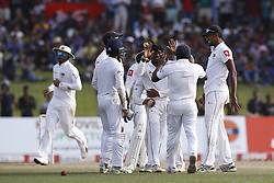 July 22, 2018 - Colombo, Sri Lanka - Sri Lankan cricketer Akila Dananjaya celebrates with team members during the 3rd day's play in the 2nd test cricket match between Sri Lanka and South Africa at SSC International Cricket ground, Colombo, Sri Lanka on Sunday  22 July 2018  (Credit Image: © Tharaka Basnayaka/NurPhoto via ZUMA Press)