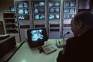 25. Security in the Principality's video control room. Security is tight in Monaco with video camaras closely observing most of the territory. There is a Police officer for every 350 inhabitants and all access to the Principality can be closed in only three minutes.   La salle de contrôle vidéo de la sûreté nationale. La principauté est  quadrillée par un système vidéo qui scrute toute la principauté. Il y a un policier pour 350 habitants et les accès à Monaco peuvent être fermés en 3 minutes  288286/11    L890523  /  P0000355