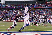 Buffalo Bills tight end Charles Clay (85) reaches high for an incomplete end zone pass while covered by New England Patriots free safety Devin McCourty (32) on a fourth down play in the fourth quarter during the 2016 NFL week 8 regular season football game against the New England Patriots on Sunday, Oct. 30, 2016 in Orchard Park, N.Y. The Patriots won the game 41-25. (©Paul Anthony Spinelli)