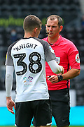 Jason Knight of Derby County  is spoken to by match referee Tim Robinson during the EFL Sky Bet Championship match between Derby County and Brentford at the Pride Park, Derby, England on 11 July 2020.