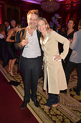 """MARK HIX and MARISSA HERMER at the presentation of Le Prix Champagne De La Joie de Vivre to Stephen Webster in celebration of his long standing contribution to """"Joie de Vivre' held at the Council Room, One Great George Street, London on 22nd April 2015."""